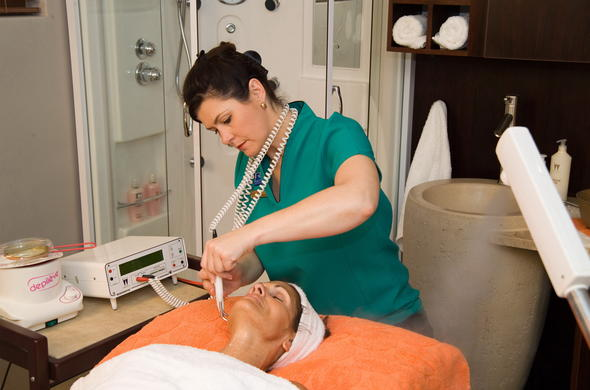 Guests enjoying a facial at the spa.